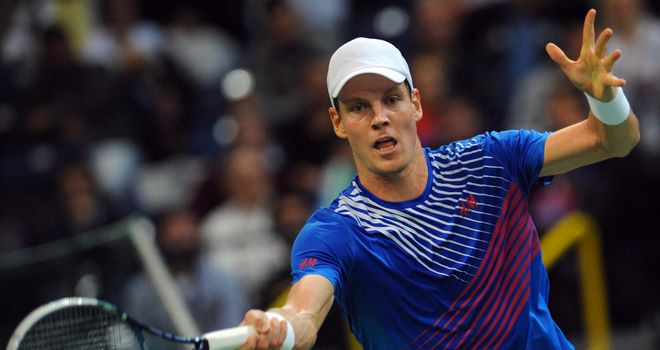 Tomas Berdych returns the ball to Serbia's Dusan Lajovic