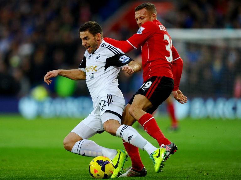 Craig Bellamy tangles with Angel Rangel on Sunday.
