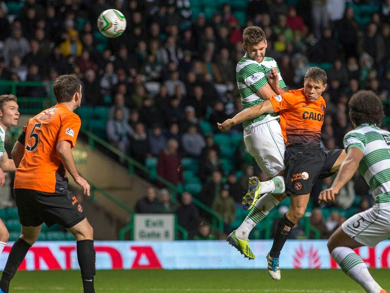 Charlie Mulgrew scores Celtic's late equaliser against Dundee United.