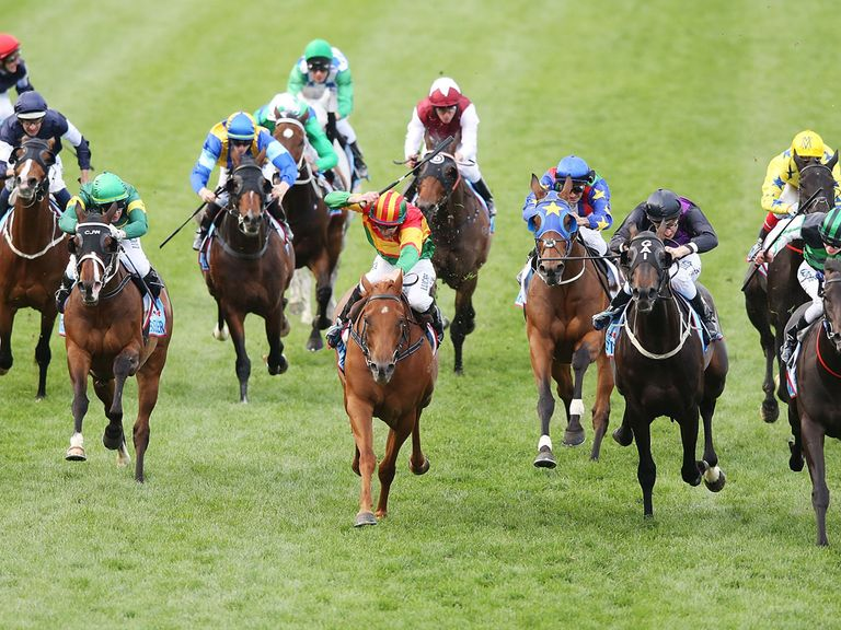 Seville (left) makes late progress into midfield in the Cox Plate