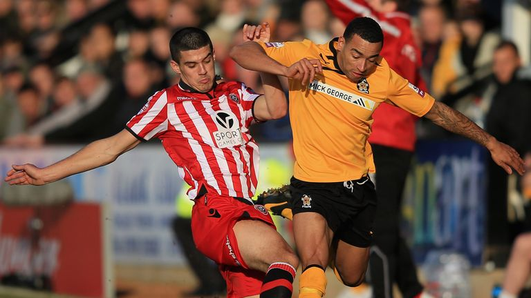 Sheffield United midfielder Conor Coady (l) tackles Cambridge's Nathan Arnold