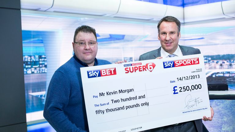 Jackpot winner Kevin Morgan is presented with his cheque from Soccer Saturday pundit Paul Merson.