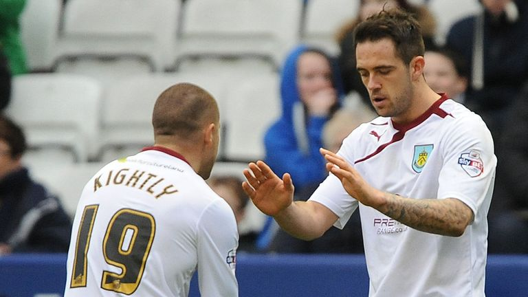 Danny Ings and Michael Kightly celebrate Burnley's leveller at King Power Stadium