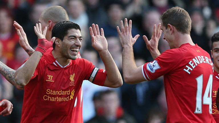 Luis Suarez: Celebrates with Jordan Henderson after scoring against Cardiff