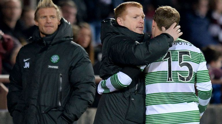 Neil Lennon congratulates Kris Commons after his hat-trick against Hearts as No 2 Johan Mjallby looks on