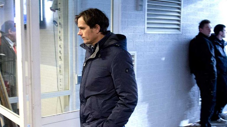 A defiant Phillip Cocu departs after seeing his side lose 6-2 to Vitesse.