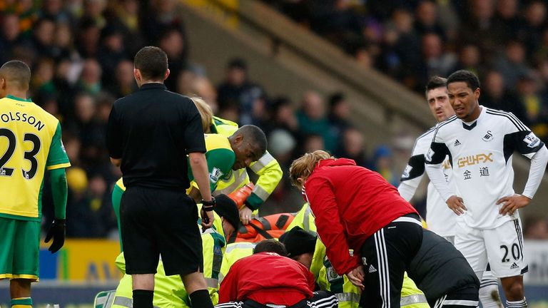 Nathan Dyer: Swansea winger taken to hospital with suspected fractured ankle