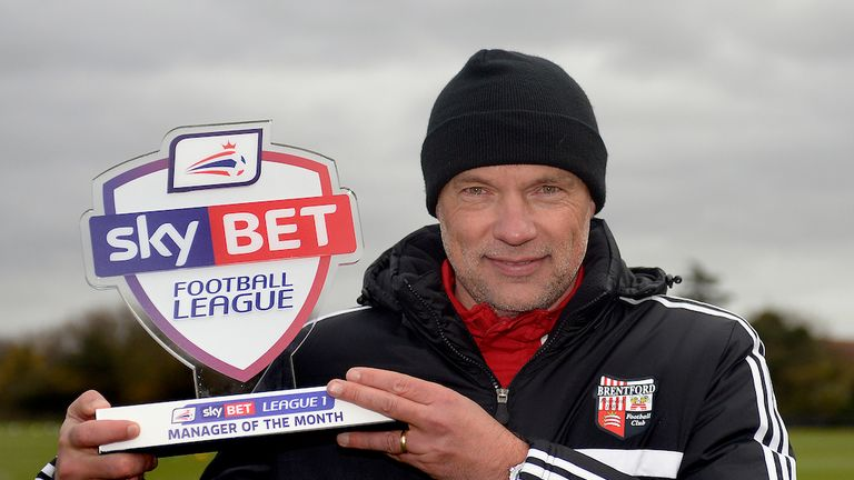 Uwe Rosler: Brentford boss poses with award