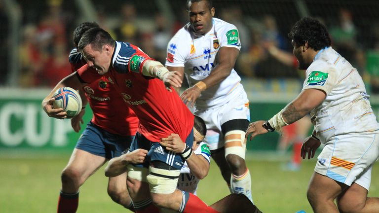 Munster's James Coughlan is tackled by Perpignan's flanker Dan Leo in last season's Heineken Cup