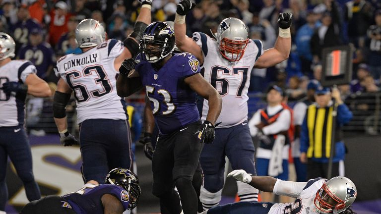 The New England Patriots celebrate a touchdown against the Baltimore Ravens