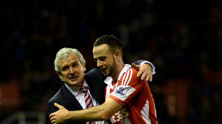 Mark Hughes: Celebrates with Marc Wilson at the final whistle