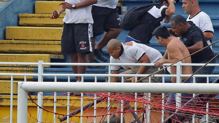 Vasco da Gama fans attack an Atletico Paranaense supporter