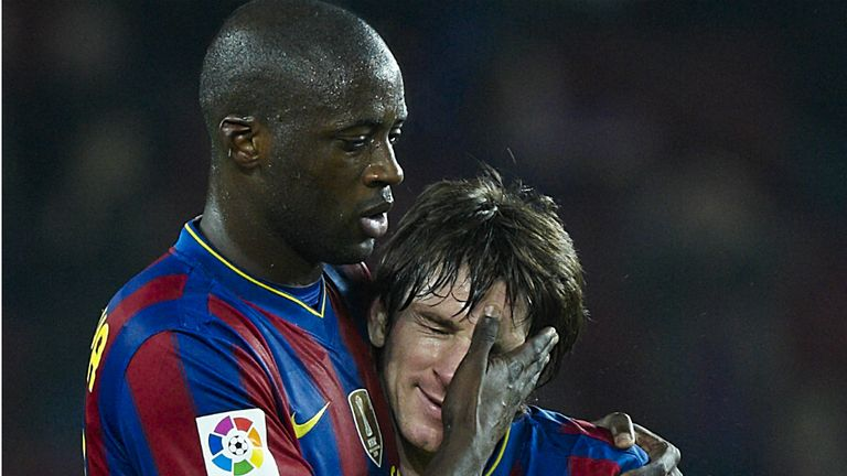 Former Barcelona midfielder Yaya Toure (l) would love to be reunited with Lionel Messi (r) at Manchester City