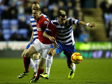 Simon Church and Danny Williams battle for possession