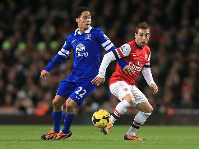 Steven Pienaar and Santi Cazorla battle for the ball