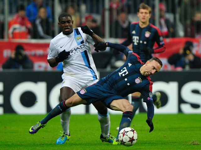 Franck Ribery is knocked over by Micah Richards