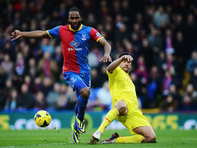 Cameron Jerome tries to skip past Steven Caulker