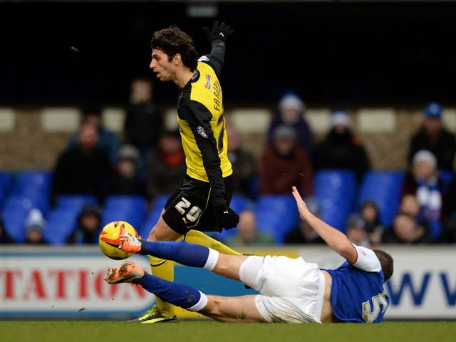Tommy Smith slides in on Diego Fabbrini