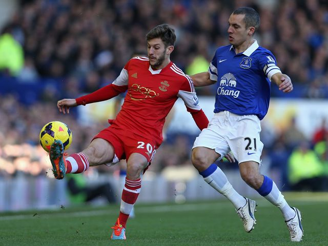 Adam Lallana is put under pressure by Leon Osman