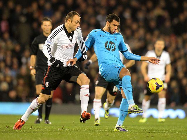 Dimitar Berbatov tackles Tottenham's Etienne Capoue