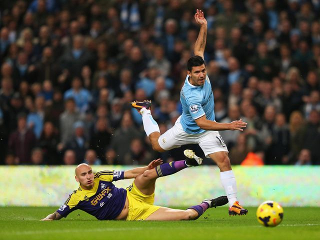 Shelvey tries to halt Aguero.