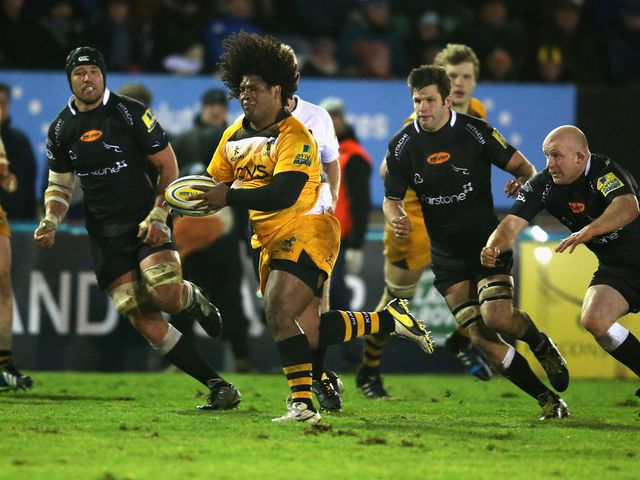 Ashley Johnson of Wasps breaks with the ball