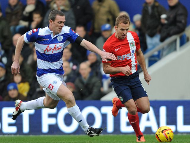 Richard Dunne and Jordan Rhodes battle for possession