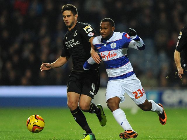 Andrew Surman and Junior Hoilett battle for the ball