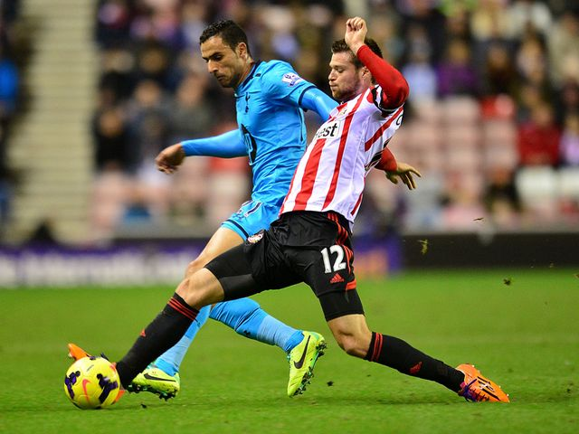 Nacer Chadli and Ondrej Celustka battle for the ball