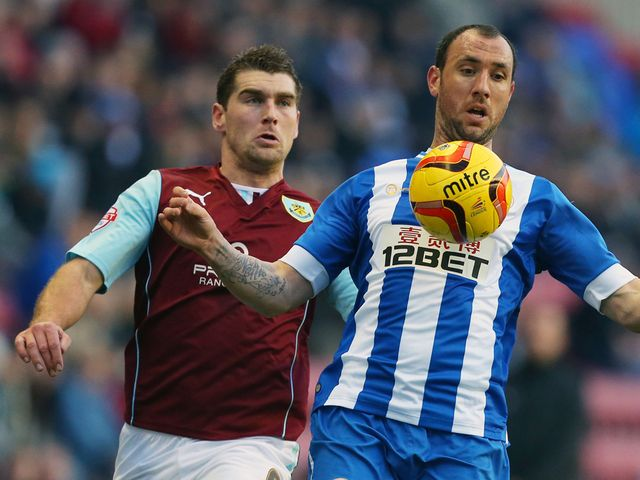 Ivan Ramis is watched by Sam Vokes