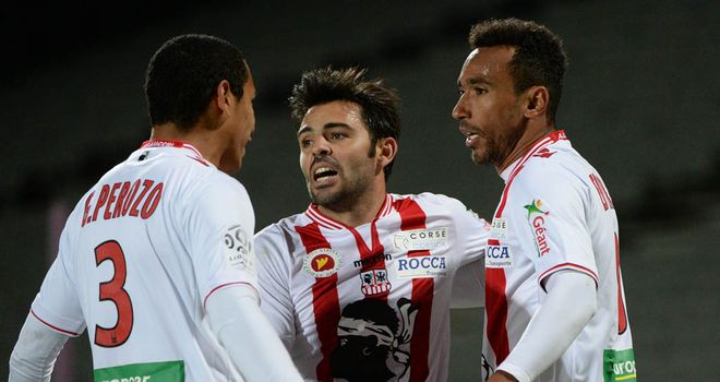 Eduardo (centre) celebrates his late Ajaccio equaliser