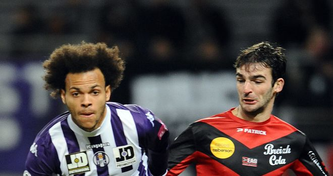 Martin Braithwaite and Christophe Kerbrat battle for the ball