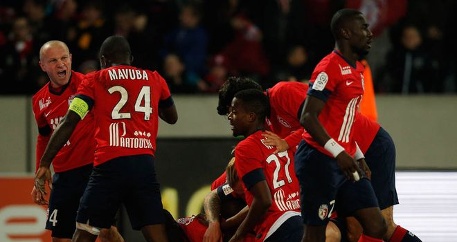 Lille celebrate Nolan Roux's late winner