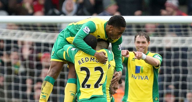 Gary Hooper: Buried beneath Norwich players celebrating his goal