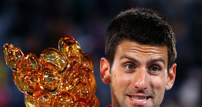 Novak Djokovic poses with the trophy in Abu Dhabi