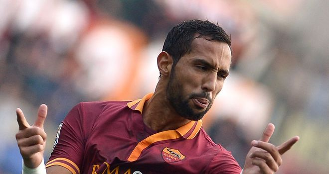 Mehdi Benatia celebrates scoring for Roma