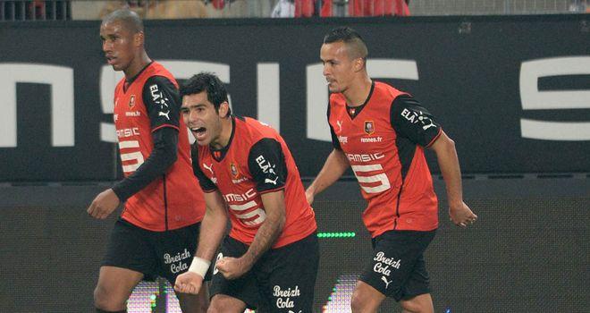 Silvio Romero (centre) celebrates his goal for Rennes
