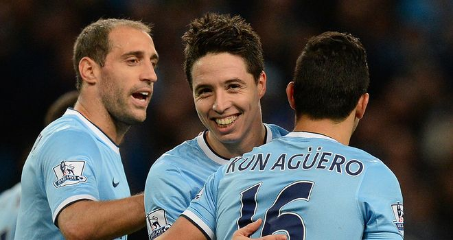 Samir Nasri (c): Celebrates one of his goals against Swansea