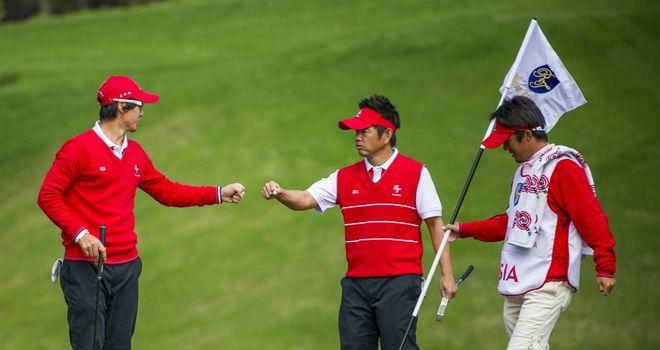 Ryo Ishikawa (L) and Hiroyuki Fujita secured a 3&2 success for Asia