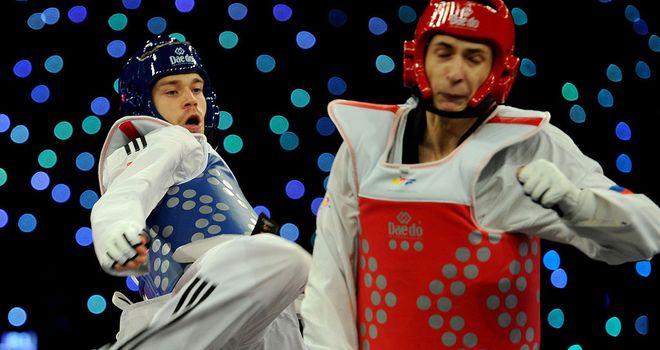 Cook in action agianst Russia's Albert Gaun in the Men's 80kg semi final