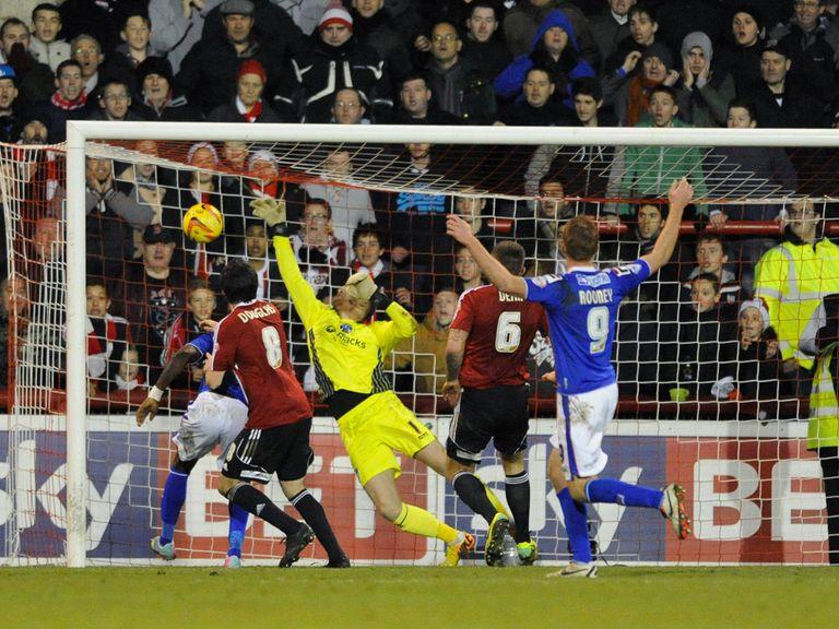 Jonathan Douglas scores Brentford's winner against Oldham.