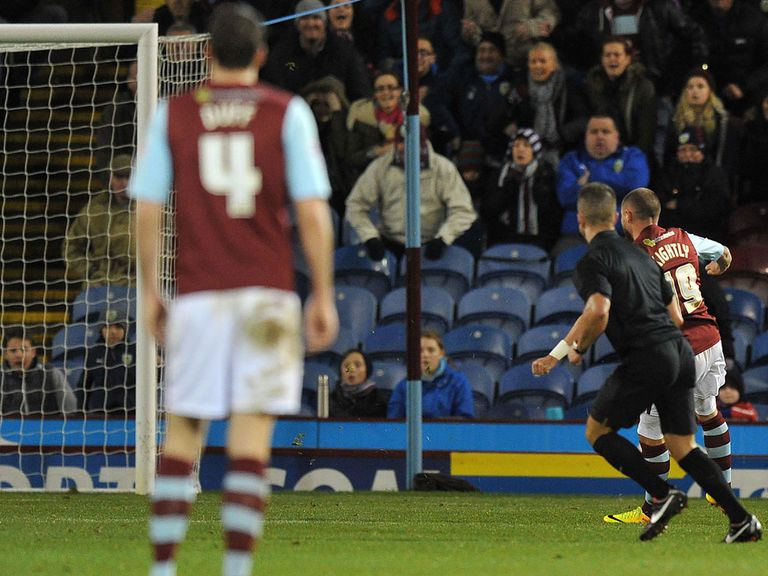 Michael Kightly scores with this strike for Burnley