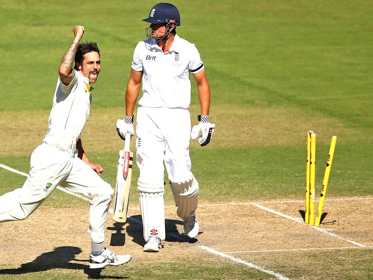 Mitchell Johnson knocks back Alastair Cook's off stump in Adelaide.