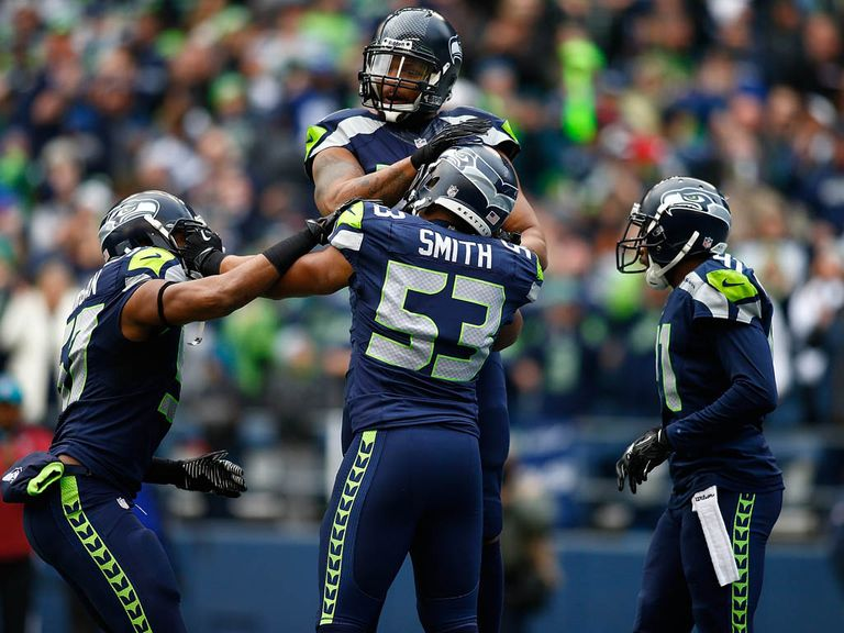 Malcolm Smith celebrates his touchdown