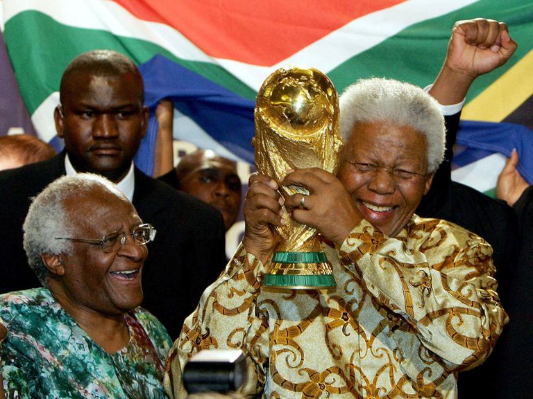 Nelson Mandela with the World Cup trophy.