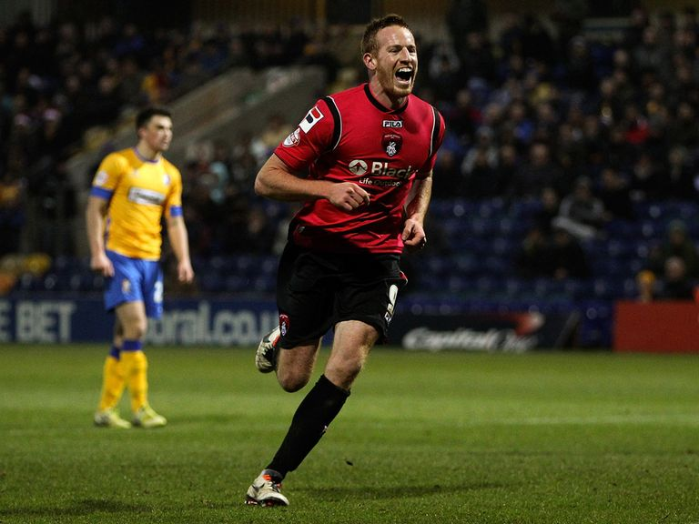 Adam Rooney celebrates as Oldham beat Mansfield.