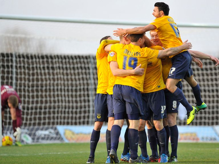 Oxford enjoy the 2-1 victory over Dagenham.