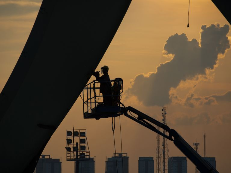 A man works at the Arena da Amazonia stadium, Manaus
