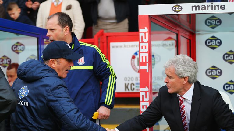 Mark Hughes: Shakes hands with old foe Tony Pulis