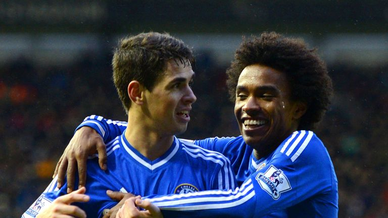 Oscar: The Brazilian celebrates with Willian after netting Chelsea's second